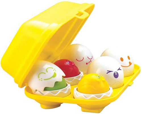 a Tomy- Toomies Piou Surprise Toy E1581 Shape And Color Sorter