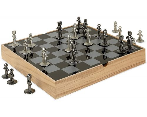 A natural wood and metal chess board